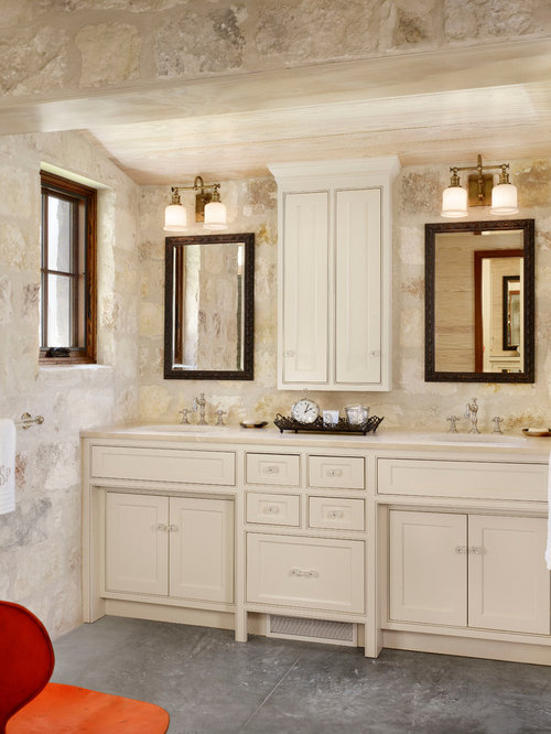 inspiration for a farmhouse stone tile bathroom remodel in houston with an undermount sink beaded