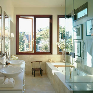 Bathroom - modern bathroom idea in San Francisco with a vessel sink and white cabinets