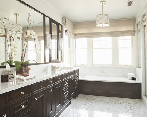 Elegant Alcove Bathtub Photo In Los Angeles With Recessed Panel Cabinets And Dark Wood