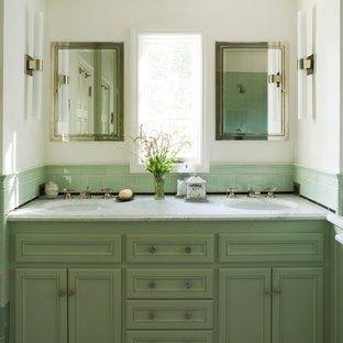 Photo of a classic bathroom in San Francisco with marble worktops and green cabinets.