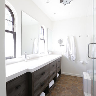 Example of a trendy brown tile terra-cotta floor and brown floor bathroom design in San Francisco with an integrated sink, dark wood cabinets and flat-panel cabinets