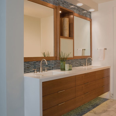 Example of a trendy blue tile and matchstick tile bathroom design in San Francisco with an undermount sink, flat-panel cabinets and medium tone wood cabinets