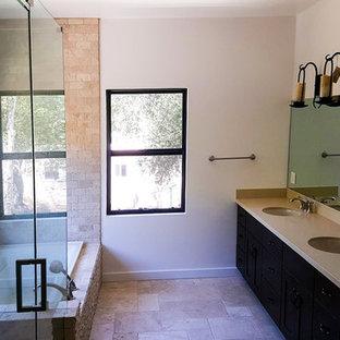 Ejemplo de cuarto de baño principal, actual, pequeño, con armarios con paneles lisos, puertas de armario marrones, bañera esquinera, ducha esquinera, baldosas y/o azulejos blancos, baldosas y/o azulejos con efecto espejo y encimera de mármol