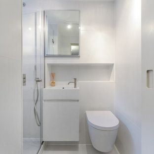 Design ideas for a contemporary shower room in London with flat-panel cabinets, white cabinets, white walls, a console sink and white floors.