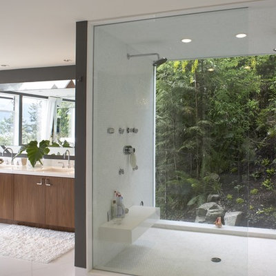 Trendy white tile alcove shower photo in Vancouver with an undermount sink, flat-panel cabinets and medium tone wood cabinets