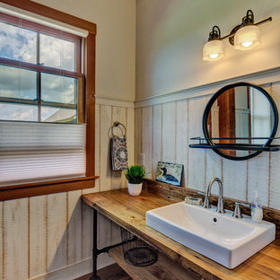 Bathroom - small country dark wood floor and brown floor bathroom idea in Manchester with open cabinets, gray walls, a vessel sink, wood countertops and brown countertops