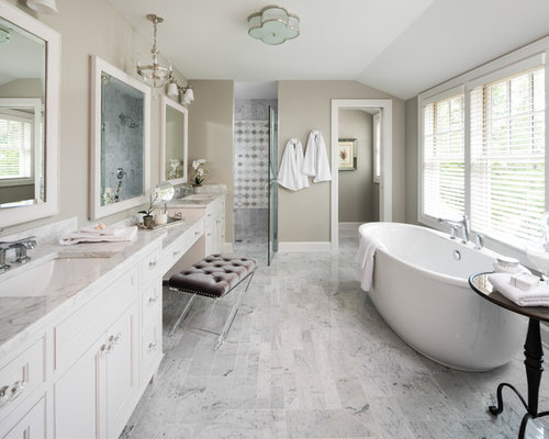 Example of a coastal master gray tile and multicolored floor  freestanding bathtub design in 10 Best Beach Style Bathroom Ideas Houzz