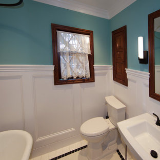 Small arts and crafts bathroom in Sacramento with a pedestal sink, recessed-panel cabinets, dark wood cabinets, a claw-foot tub, an open shower, a two-piece toilet, white tile, porcelain tile, blue walls and mosaic tile floors.