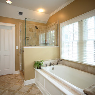 Bathroom - mid-sized traditional master beige tile and stone tile travertine floor bathroom idea in Boston with shaker cabinets, white cabinets, marble countertops, beige walls and an undermount sink