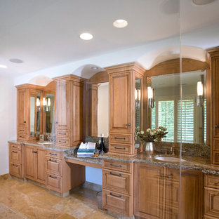 His and her master bath vanity cabinets with makeup table