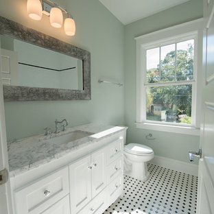 Ornate black and white tile ceramic floor alcove bathtub photo in Jacksonville with shaker cabinets, white cabinets, gray walls and marble countertops