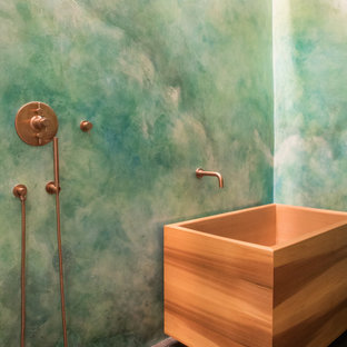 Design ideas for a modern master bathroom in Seattle with a japanese tub, an open shower, green tile, multi-coloured walls, porcelain floors, black floor and an open shower.