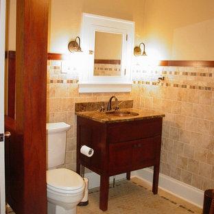 Ispirazione per una stanza da bagno padronale stile americano di medie dimensioni con lavabo sottopiano, ante lisce, ante in legno bruno, top in marmo, vasca da incasso, vasca/doccia, WC a due pezzi, piastrelle beige, piastrelle in ceramica, pareti marroni e pavimento con piastrelle in ceramica
