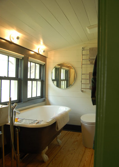 Farmhouse Bathroom by Tim Cuppett Architects