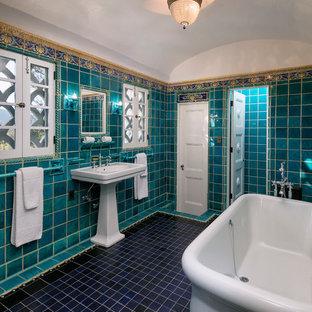 Bathroom - small mediterranean master ceramic tile ceramic floor bathroom idea in Los Angeles with blue walls and a pedestal sink