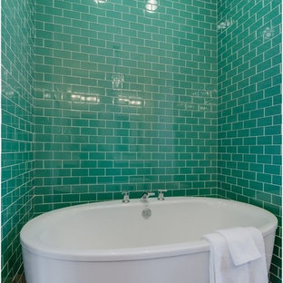 Design ideas for a mid-sized master bathroom in Albuquerque with an undermount sink, recessed-panel cabinets, medium wood cabinets, solid surface benchtops, a drop-in tub, white tile, white walls and ceramic floors.
