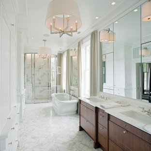 This is an example of a traditional ensuite bathroom in Atlanta with a submerged sink, freestanding cabinets, dark wood cabinets, a freestanding bath, an alcove shower and white tiles.