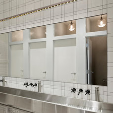 Industrial Bathroom by Jeff King & Company