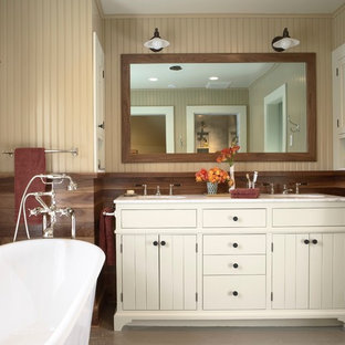 Inspiration for a mid-sized farmhouse master painted wood floor freestanding bathtub remodel in Minneapolis with an undermount sink, marble countertops, beige walls and white cabinets