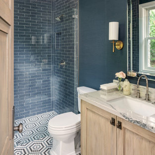 Alcove shower - mid-sized transitional 3/4 mosaic tile floor and multicolored floor alcove shower idea in Salt Lake City with recessed-panel cabinets, light wood cabinets, blue walls, an undermount sink, beige countertops, marble countertops and a hinged shower door