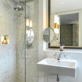 Design ideas for a contemporary bathroom in London with an alcove shower, grey tiles, white tiles, marble tiles, white walls, a wall-mounted sink and grey floors.