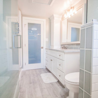 Alcove shower - small contemporary 3/4 blue tile and glass tile porcelain floor alcove shower idea in Los Angeles with shaker cabinets, white cabinets, a one-piece toilet, blue walls, an undermount sink and marble countertops