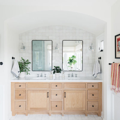 Transitional white tile white floor and double-sink bathroom photo in Los Angeles with flat-panel cabinets, beige cabinets, white walls, an undermount sink and white countertops