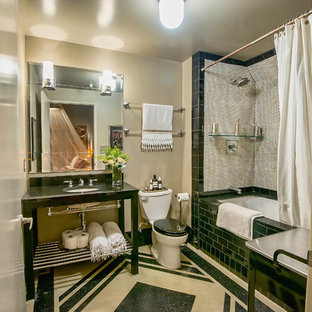 Inspiration for a mid-sized transitional black and white tile and mosaic tile bathroom remodel in Los Angeles with open cabinets, a two-piece toilet, beige walls and a console sink