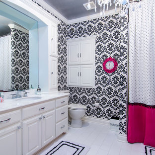 Mid-sized trendy kids' white tile and ceramic tile ceramic tile bathroom photo in Dallas with open cabinets, white cabinets, a two-piece toilet, black walls, an undermount sink and marble countertops