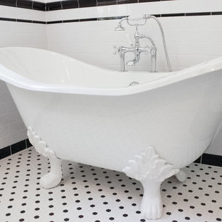 Claw-foot bathtub - mid-century modern white tile claw-foot bathtub idea in Los Angeles with a pedestal sink
