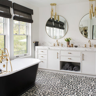 Inspiration for a transitional multicolored floor freestanding bathtub remodel in Los Angeles with recessed-panel cabinets, white cabinets, white walls, an undermount sink and white countertops