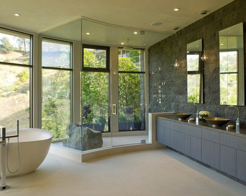 Example Of A Trendy Freestanding Bathtub Design In Los Angeles With A  Vessel Sink