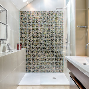 Inspiration for a contemporary multicolored tile alcove shower remodel in London with an integrated sink, flat-panel cabinets, dark wood cabinets and beige walls