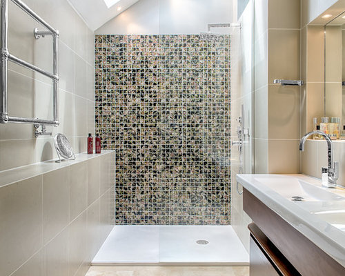 Inspiration for a contemporary multicolored tile alcove shower remodel in  London with an integrated sink,