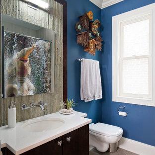Imagen de cuarto de baño infantil, clásico renovado, de tamaño medio, con lavabo bajoencimera, armarios con paneles lisos, puertas de armario de madera en tonos medios, sanitario de pared, baldosas y/o azulejos de piedra, encimera de piedra caliza, baldosas y/o azulejos grises y suelo de baldosas de porcelana