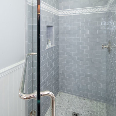 Alcove shower - small traditional 3/4 subway tile marble floor alcove shower idea in Los Angeles with a two-piece toilet, gray walls, an undermount sink, marble countertops, recessed-panel cabinets and white cabinets