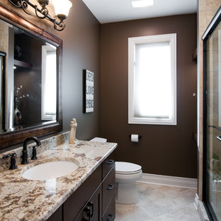 Sliding shower door - mid-sized traditional 3/4 beige tile and travertine tile travertine floor and beige floor sliding shower door idea in Chicago with shaker cabinets, brown cabinets, brown walls, an undermount sink and granite countertops