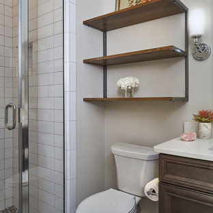 Alcove shower - small transitional 3/4 white tile and subway tile alcove shower idea in Atlanta with raised-panel cabinets, dark wood cabinets, a one-piece toilet, gray walls, an undermount sink and granite countertops