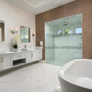 Inspiration for a large transitional master marble floor bathroom remodel in Miami with recessed-panel cabinets, white cabinets, brown walls, a vessel sink and a hinged shower door