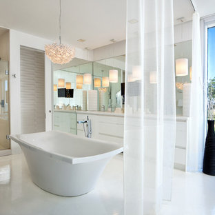Inspiration for a large contemporary master white tile bathroom remodel in Richmond with flat-panel cabinets, white cabinets, solid surface countertops and white walls