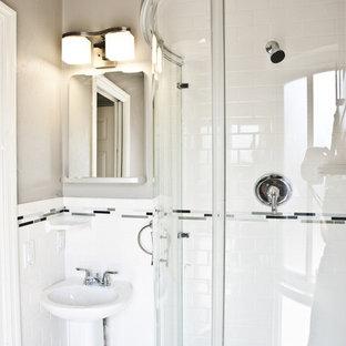Corner shower - transitional white tile and subway tile corner shower idea in Tampa with a pedestal sink