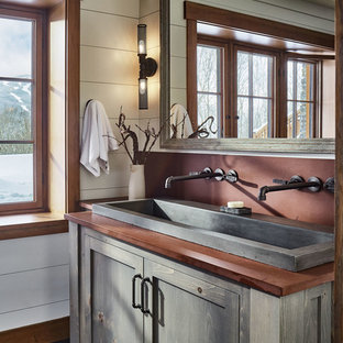 Inspiration for a rustic gray floor bathroom remodel in Burlington with shaker cabinets, gray cabinets, white walls, a trough sink and brown countertops