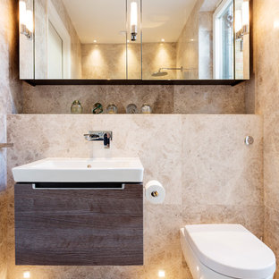 Photo of a mediterranean bathroom in London with a wall mounted toilet and a pedestal sink.