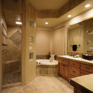 Photo of a large mediterranean ensuite bathroom in Denver with shaker cabinets, medium wood cabinets, a walk-in shower, beige tiles, brown tiles, mosaic tiles, beige walls, ceramic flooring, a submerged sink and a built-in bath.