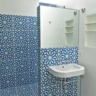 This is an example of an eclectic bathroom in Los Angeles with cement tile.