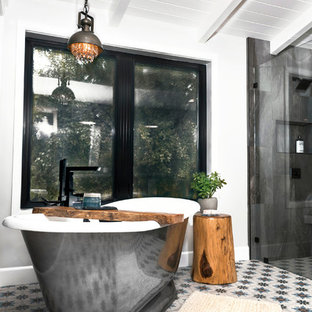 Medium sized farmhouse ensuite bathroom in Sacramento with a freestanding bath, a built-in shower, a two-piece toilet, metal tiles, white walls, mosaic tile flooring, a built-in sink, white floors, an open shower and white worktops.