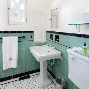 Mediterranean bathroom in Santa Barbara with a pedestal sink, a two-piece toilet, blue tiles and white walls.