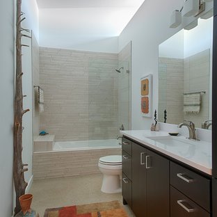 Inspiration for a mid-sized asian master beige tile and stone tile concrete floor bathroom remodel in Austin with an undermount sink, flat-panel cabinets, dark wood cabinets and white walls