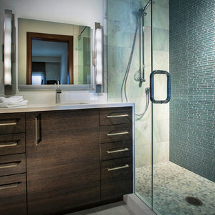 Alcove shower - mid-sized contemporary 3/4 blue tile and glass tile cement tile floor and gray floor alcove shower idea in Denver with flat-panel cabinets, dark wood cabinets, a two-piece toilet, white walls, an undermount sink, marble countertops and a hinged shower door