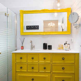 Eclectic white tile walk-in shower photo in Other with furniture-like cabinets, yellow cabinets and white walls